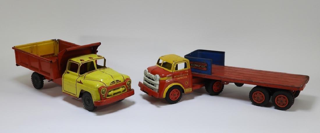 2 Wyandotte Tin Lithograph Construction Dump Truck
