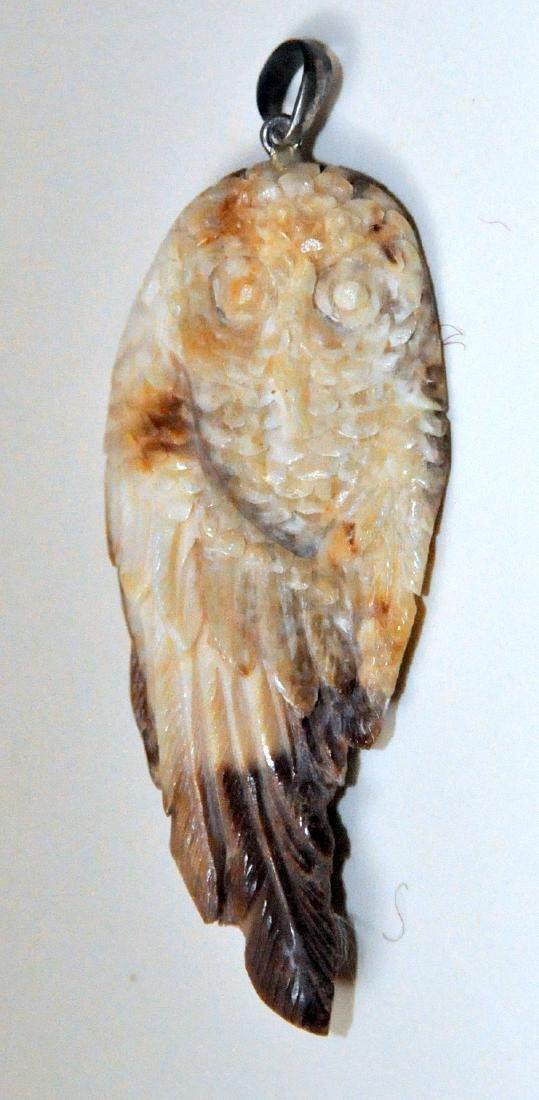 Prehistoric owl pendant carved