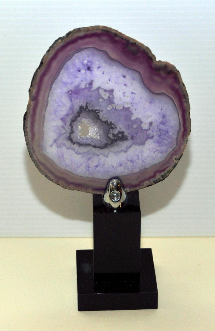 Sliced agate geode on stand