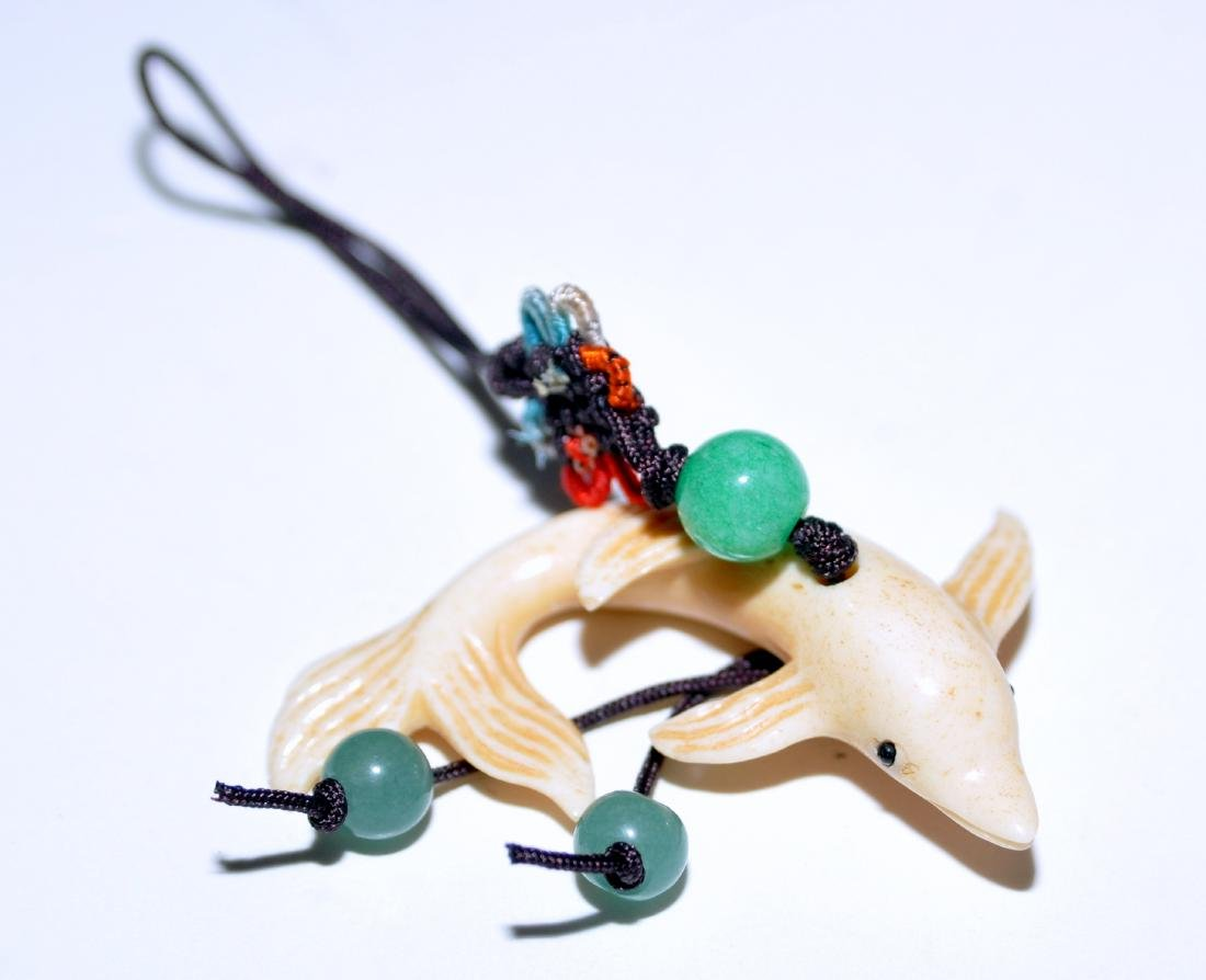 Dolphin carved pendant cream color