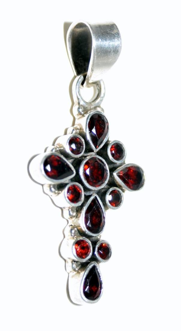 Garnet cross sterling pendant