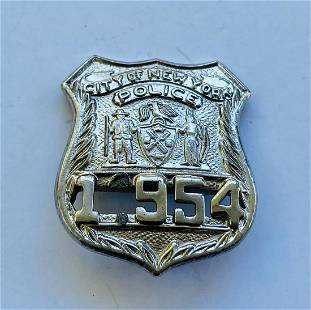 City of NY police badge with number