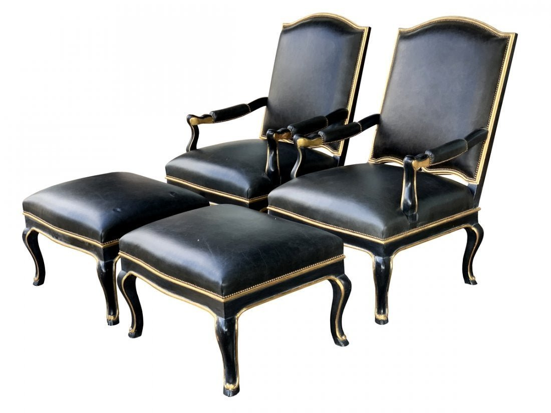Pair of black leather armchairs and ottomans, ca 1960