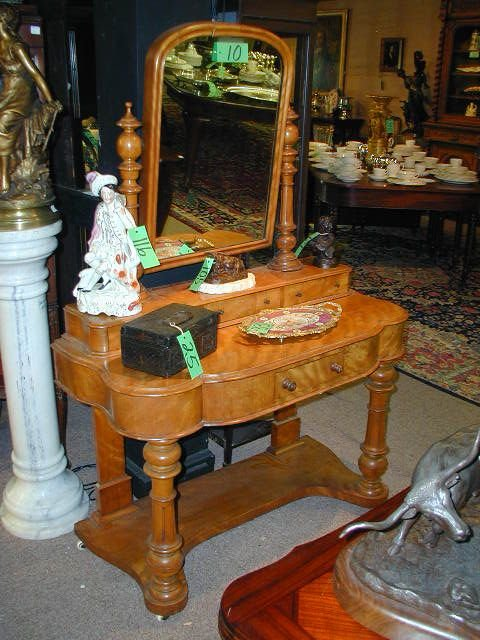 10: A VICTORIAN CARVED MAPLE dresser.  The swing mirror