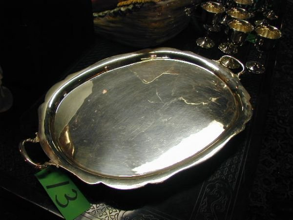 13: A STERLING SILVER TWO-HANDLE  tray with shaped scal