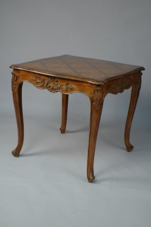 24: A LOUIS XV STYLE FRUITWOOD GAMES TABLE, the shaped