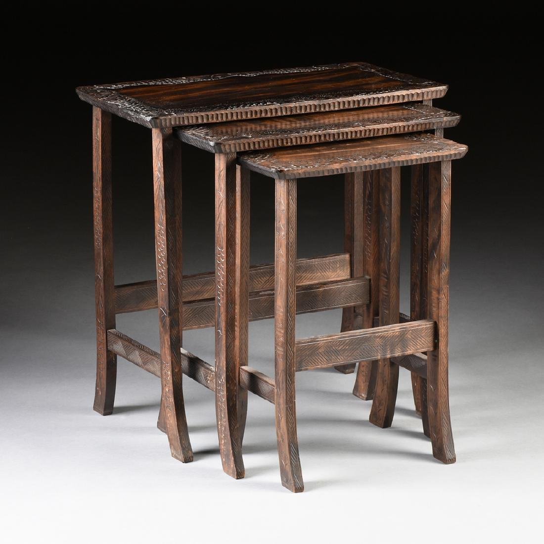 A SET OF THREE JAPANESE CARVED HARDWOOD NESTING TABLES,