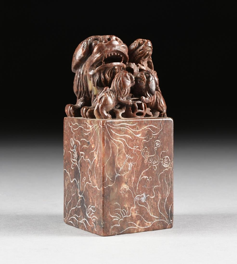 A CHINESE CARVED BROWN HARDSTONE SEAL FORM WITH A FU