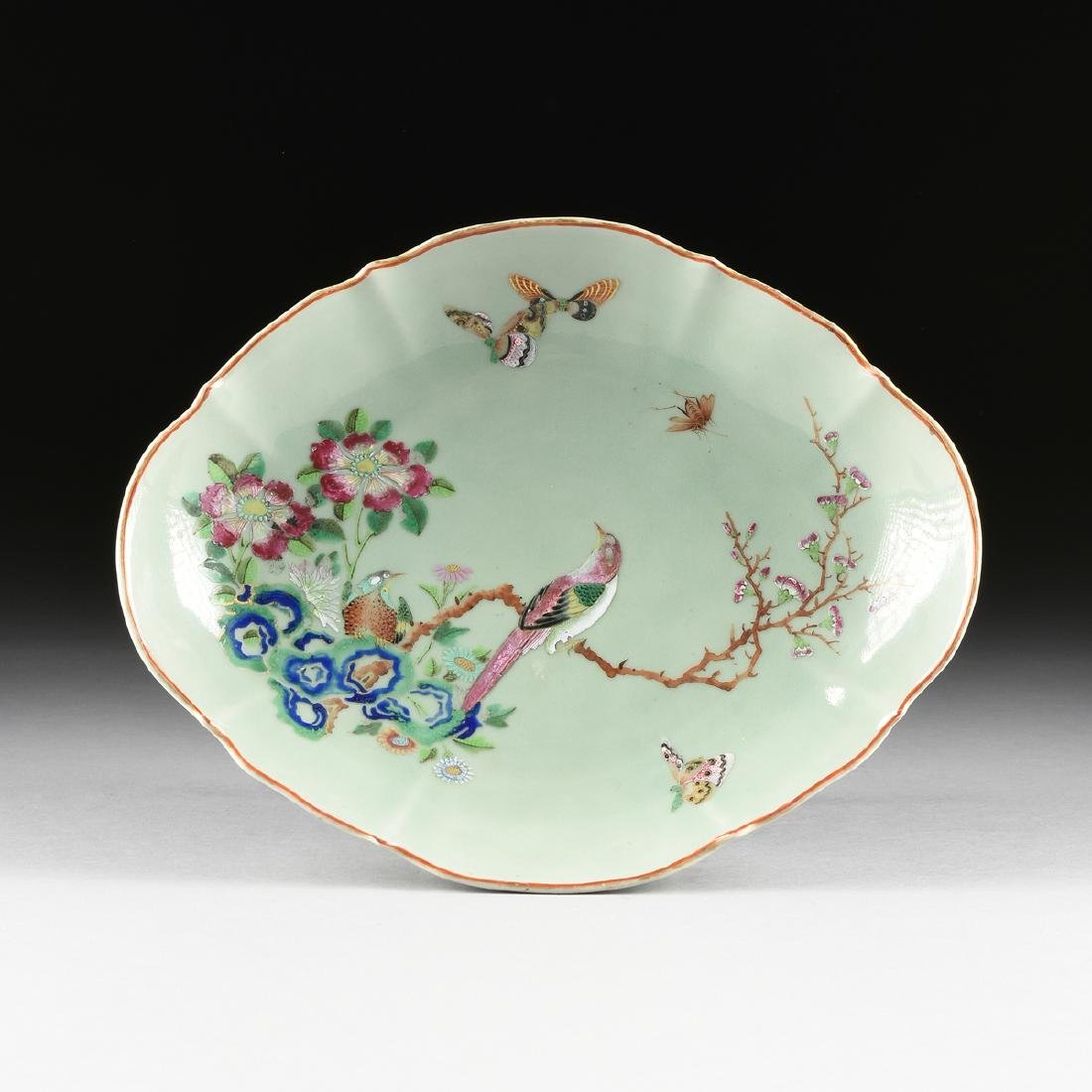 A CHINESE CELADON PORCELAIN OVAL DISH ON STAND WITH