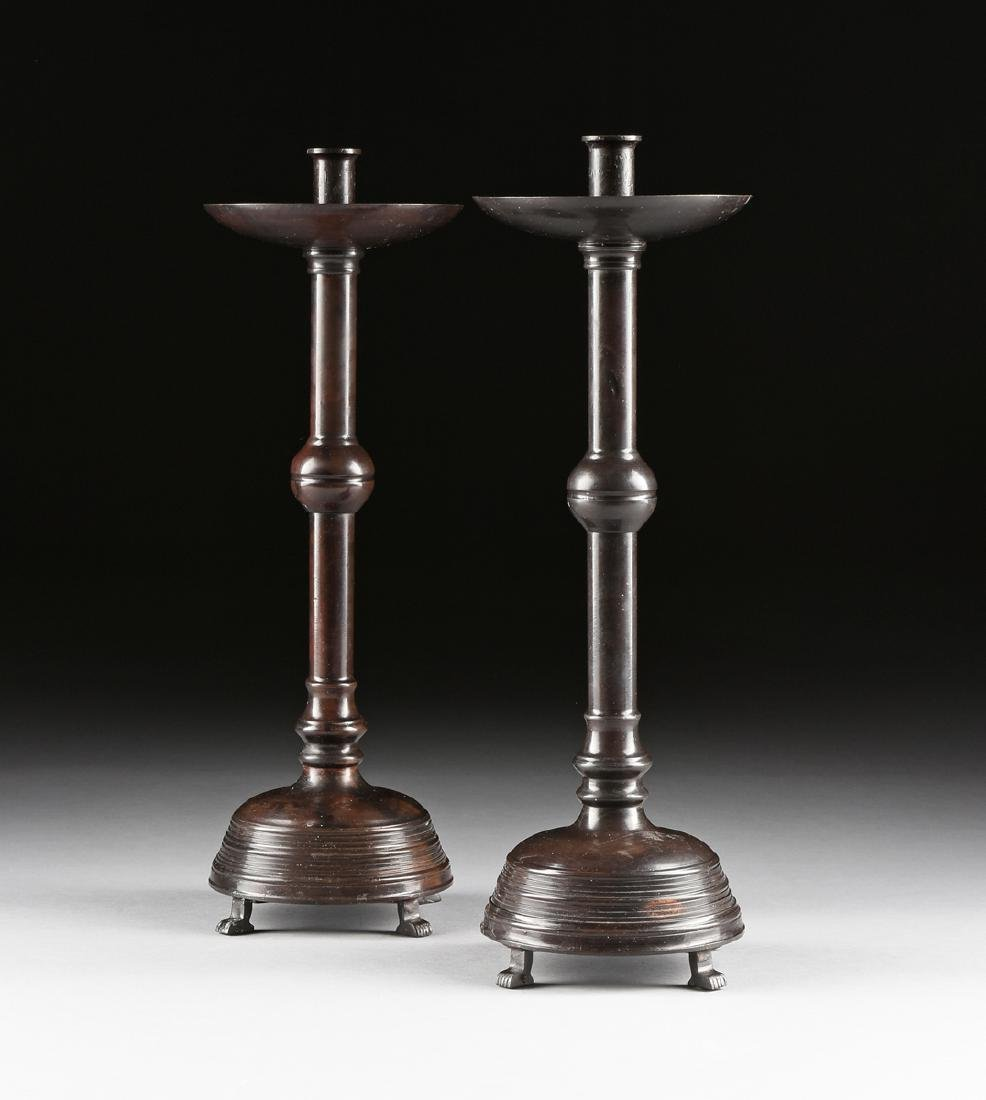 A PAIR OF MAITLAND SMITH PATINATED BRONZE TALL CANDLE
