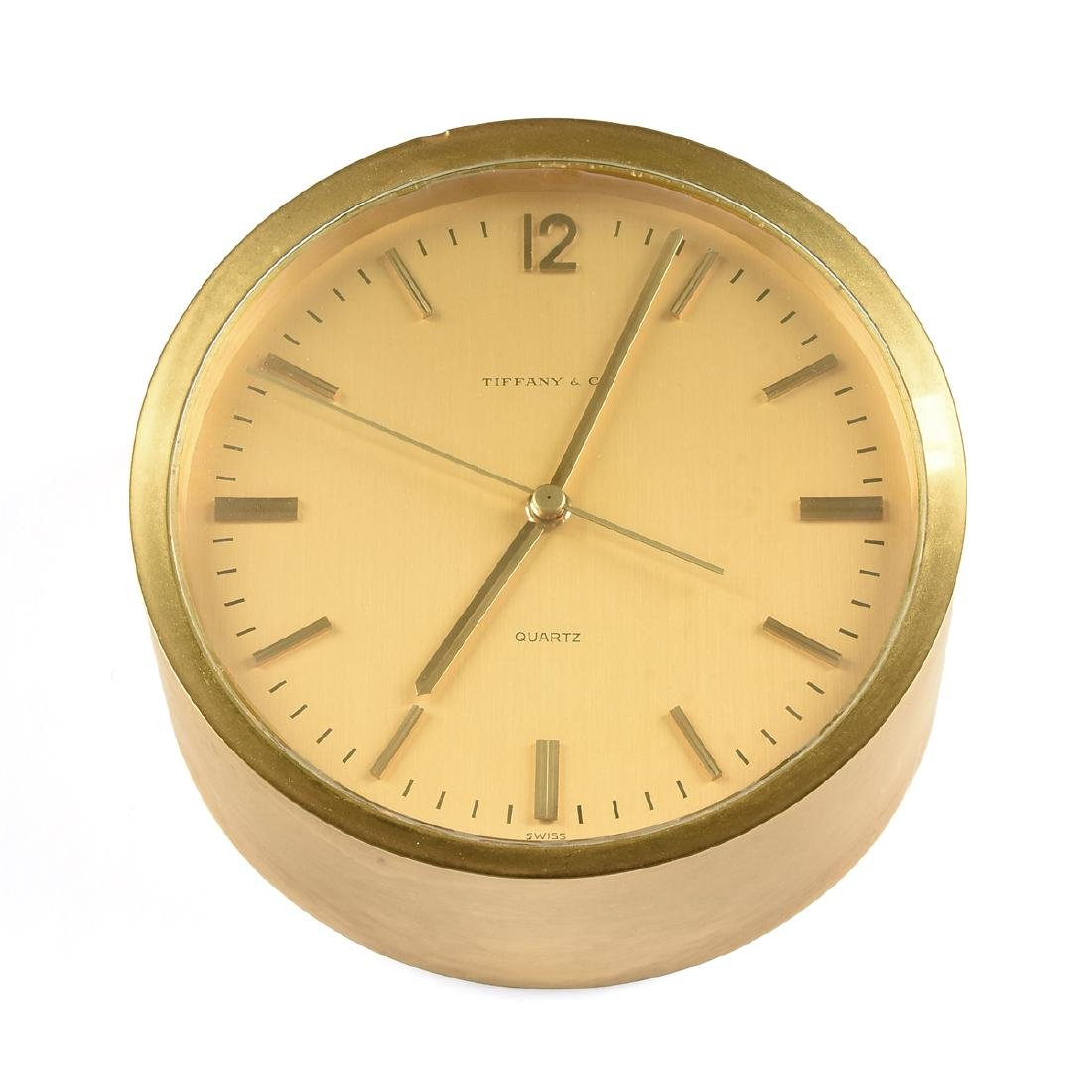 A TIFFANY & CO. SWISS MADE BRASS AND GOLD TONE QUARTZ