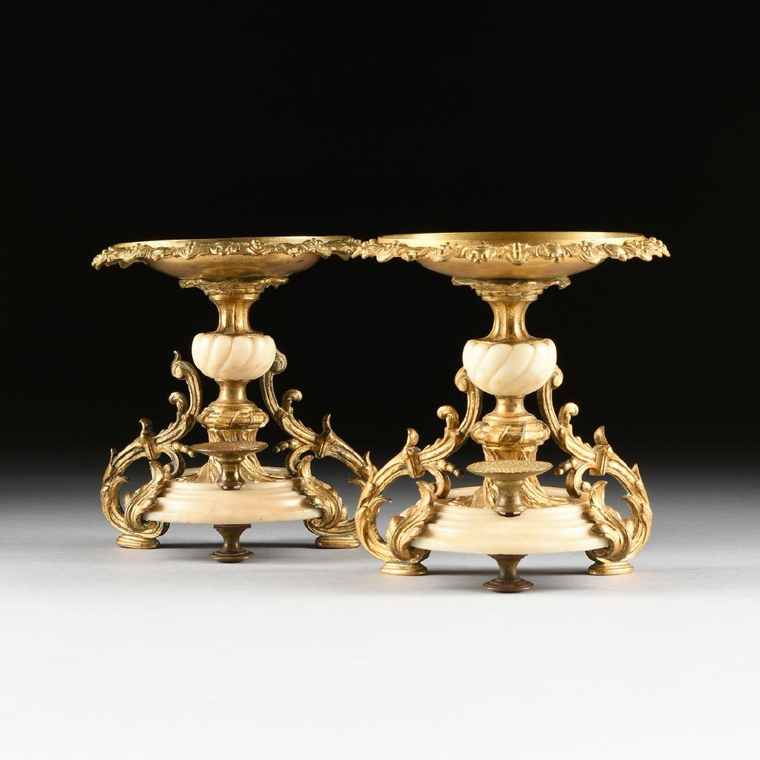 A PAIR OF CONTINENTAL GILT BRONZE AND WHITE MARBLE
