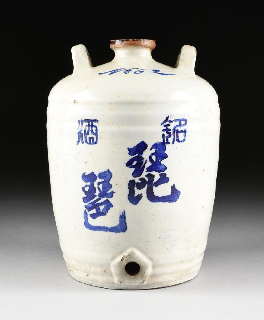 A CHINESE BLUE AND WHITE GLAZED EARTHENWARE TWO HANDLED
