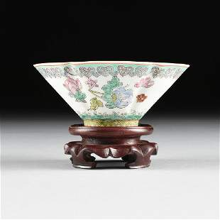 A CHINESE EXPORT FAMILLE ROSE RICEWARE PORCELAIN CUP ON