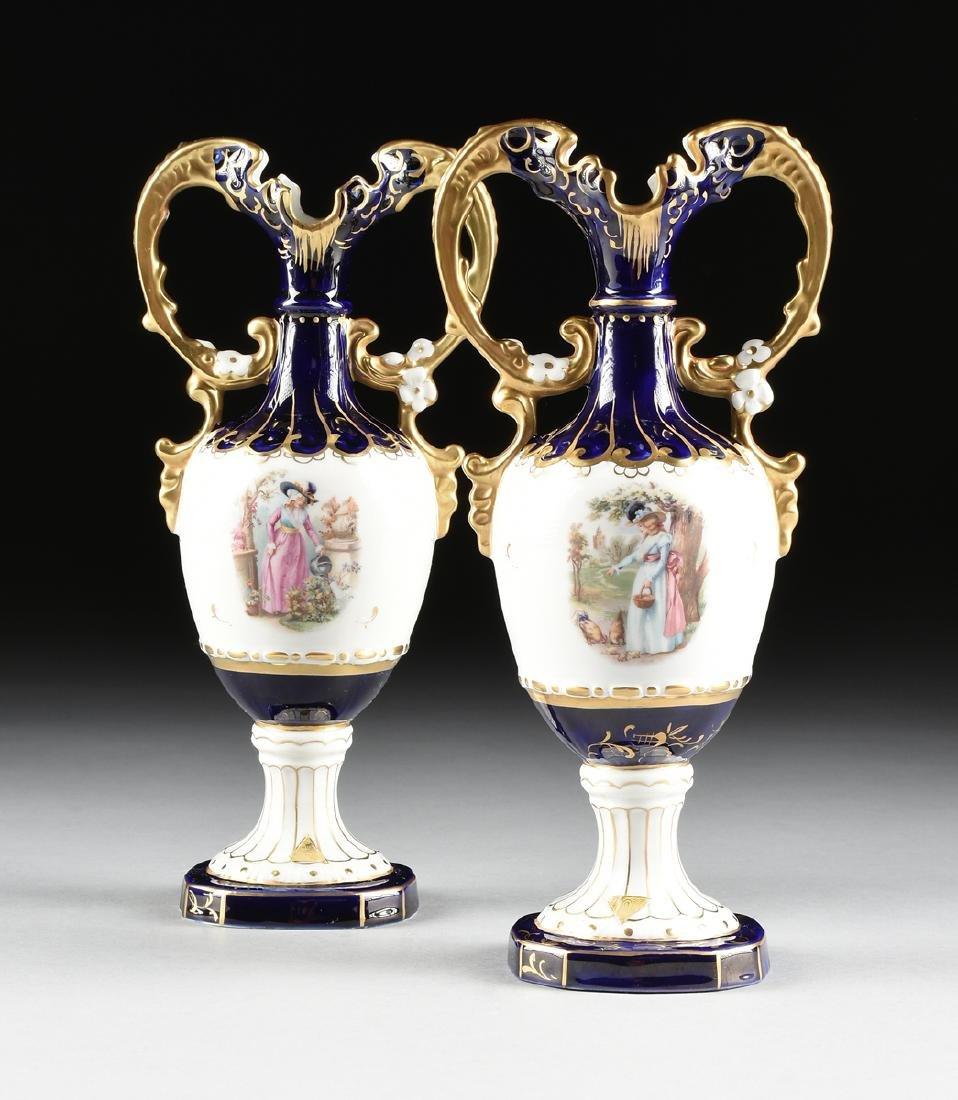A PAIR OF ROYAL DUX GILT AND TRANSFER PRINT DECORATED
