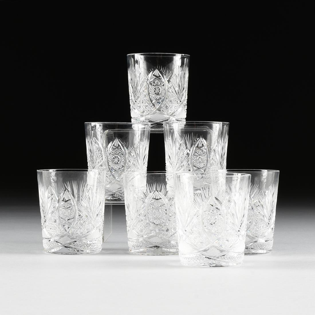 A SET OF SEVEN CUT AND ETCHED CRYSTAL TUMBLERS,
