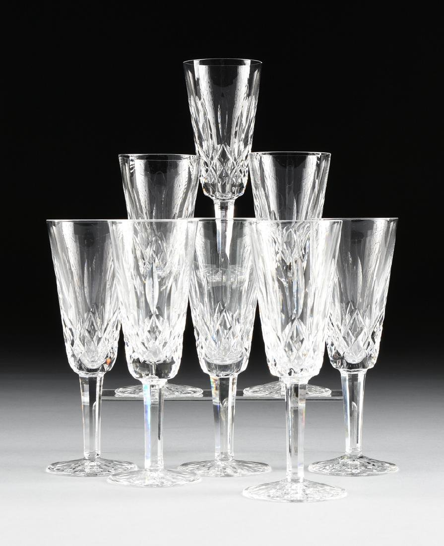 A SET OF EIGHT WATERFORD CUT CRYSTAL CHAMPAGNE FLUTES