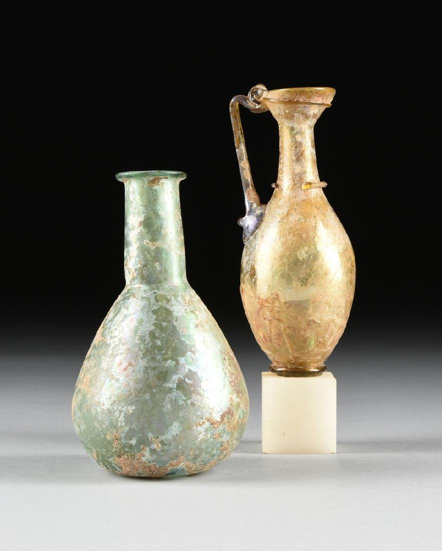 A GROUP OF TWO ANCIENT ROMAN BLOWN GLASS VESSELS, AD