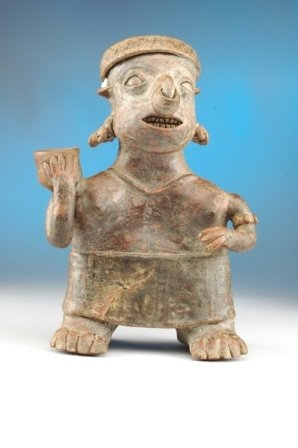 9: A PRE-COLUMBIAN NAYARIT female figure standing with