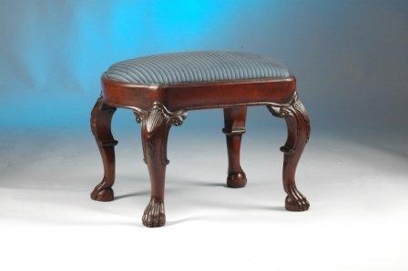 12: A GEORGE III STYLE MAHOGANY stool having a shaped r