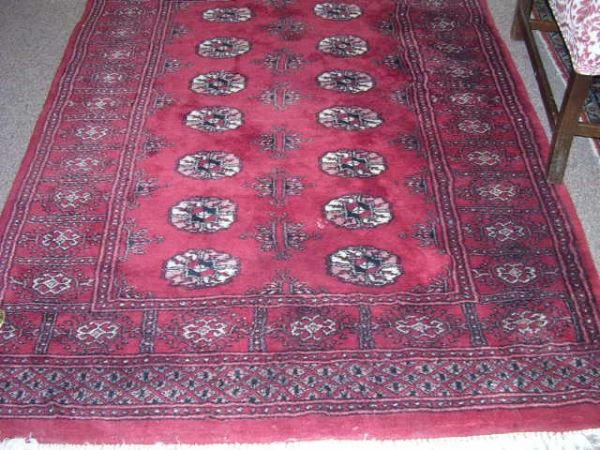 13: A BOKHARA RUG,  the tomato red field with double ro