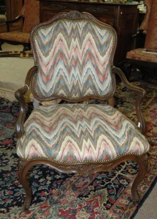 17: AN 18TH CENTURY LOUIS XV style fauteuil, the shaped