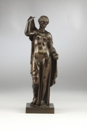 83: A BRONZE FIGURE OF A CLASSICAL MAIDEN shown standin