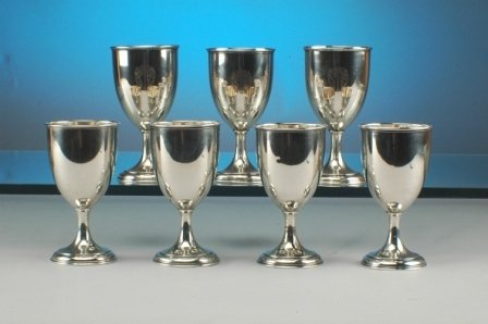 262: A SERVICE OF SEVEN STERLING SILVER wine goblets by