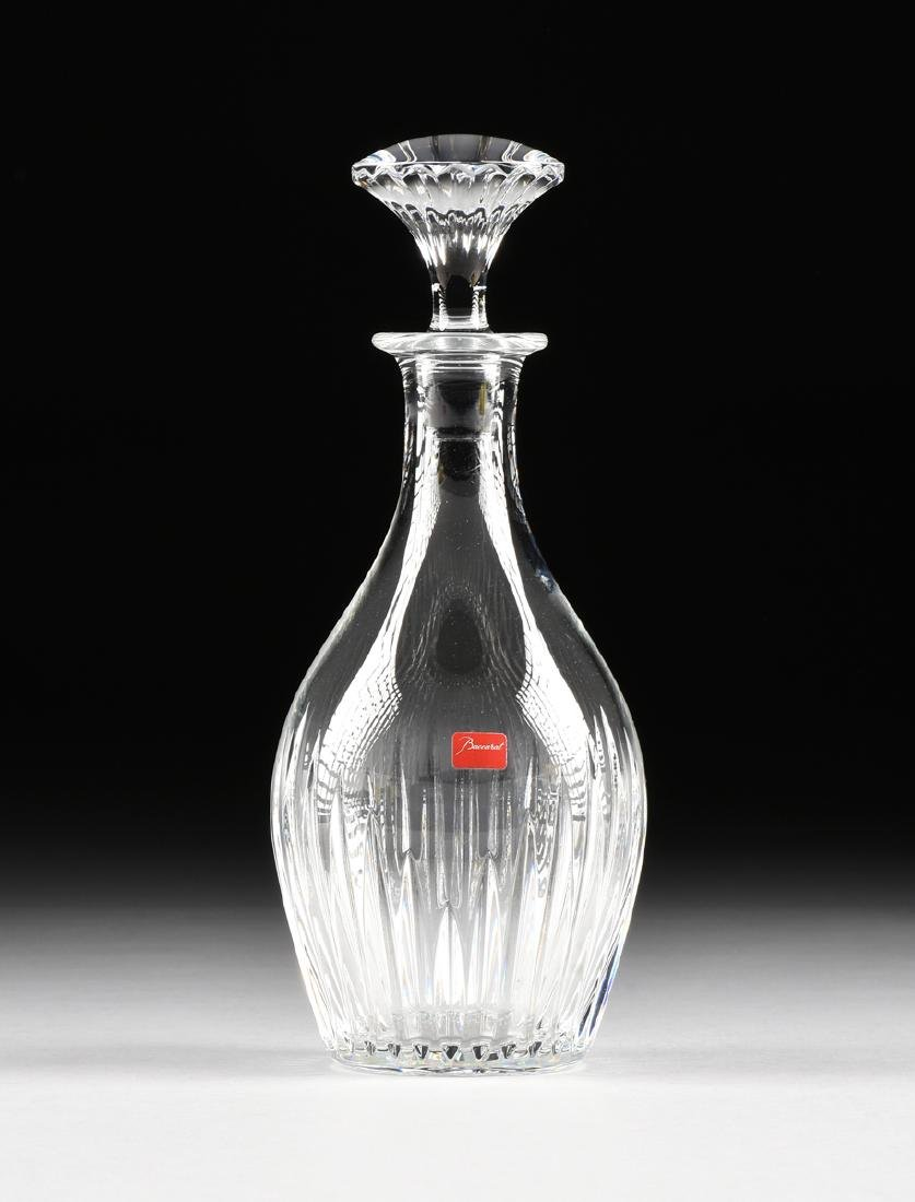 A CASED BACCARAT CUT GLASS DECANTER WITH STOPPER IN THE