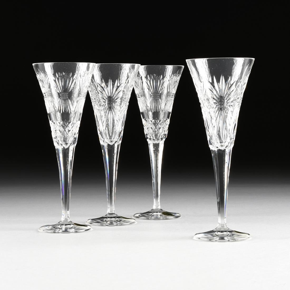 A GROUP OF FOUR WATERFORD CUT CRYSTAL FLUTED CHAMPAGNE