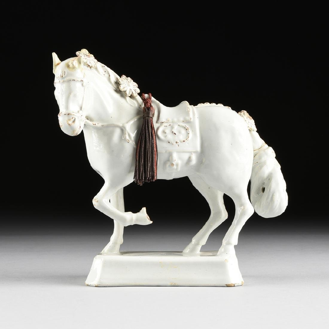A CHINESE EXPORT GLAZED STONEWARE FIGURE OF A HORSE,