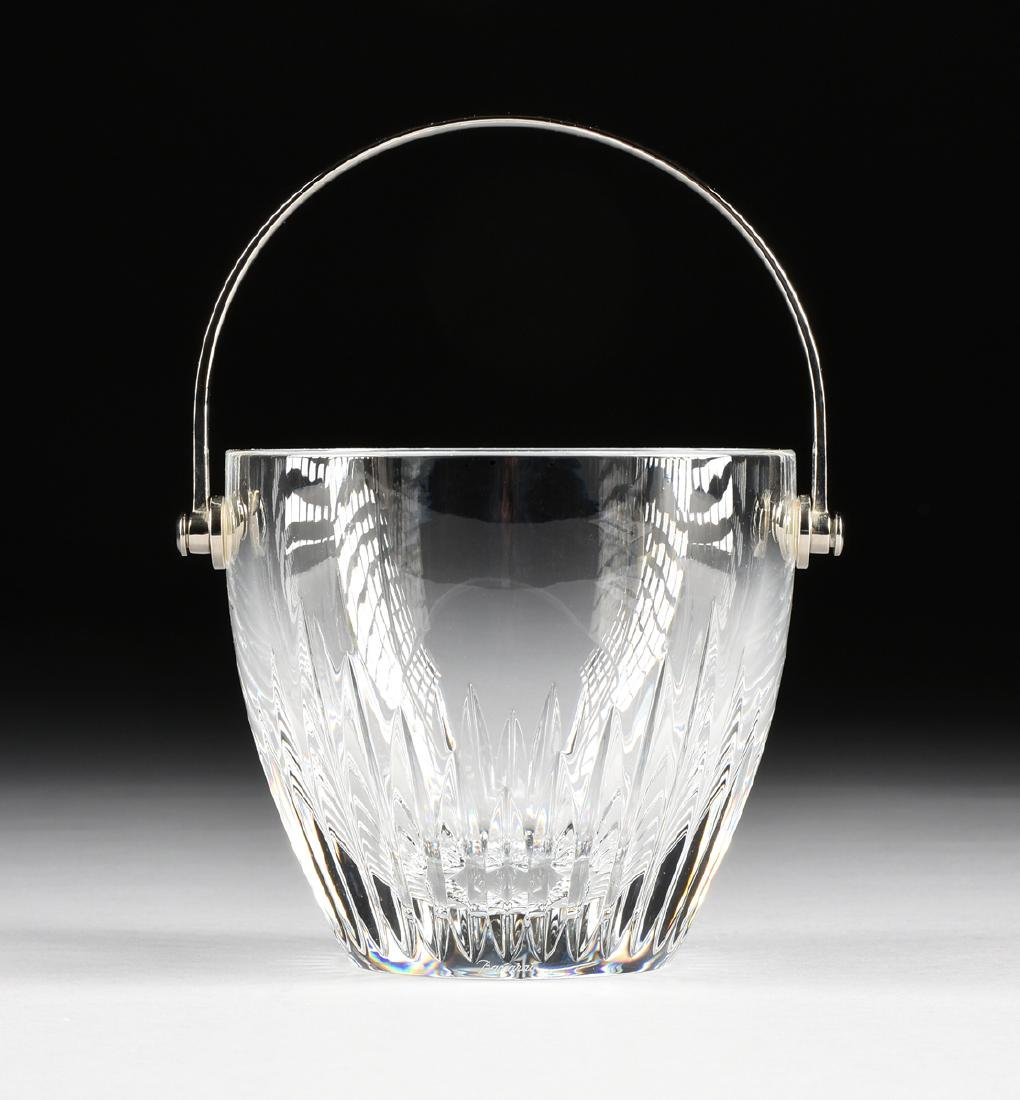 A CASED BACCARAT CUT CRYSTAL ICE BUCKET WITH SILVERED