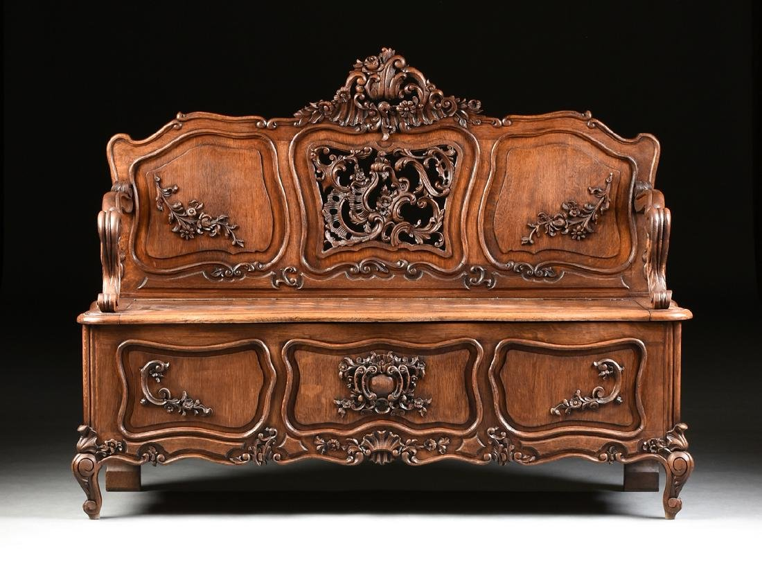 A LOUIS XV PROVINCIAL STYLE PARQUETRY INLAID CARVED OAK