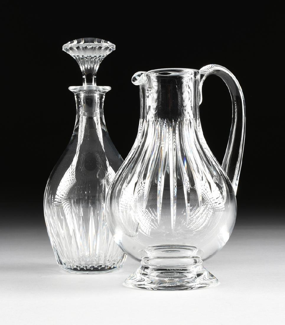 A GROUP OF TWO BACCARAT CUT CRYSTAL VESSELS IN THE