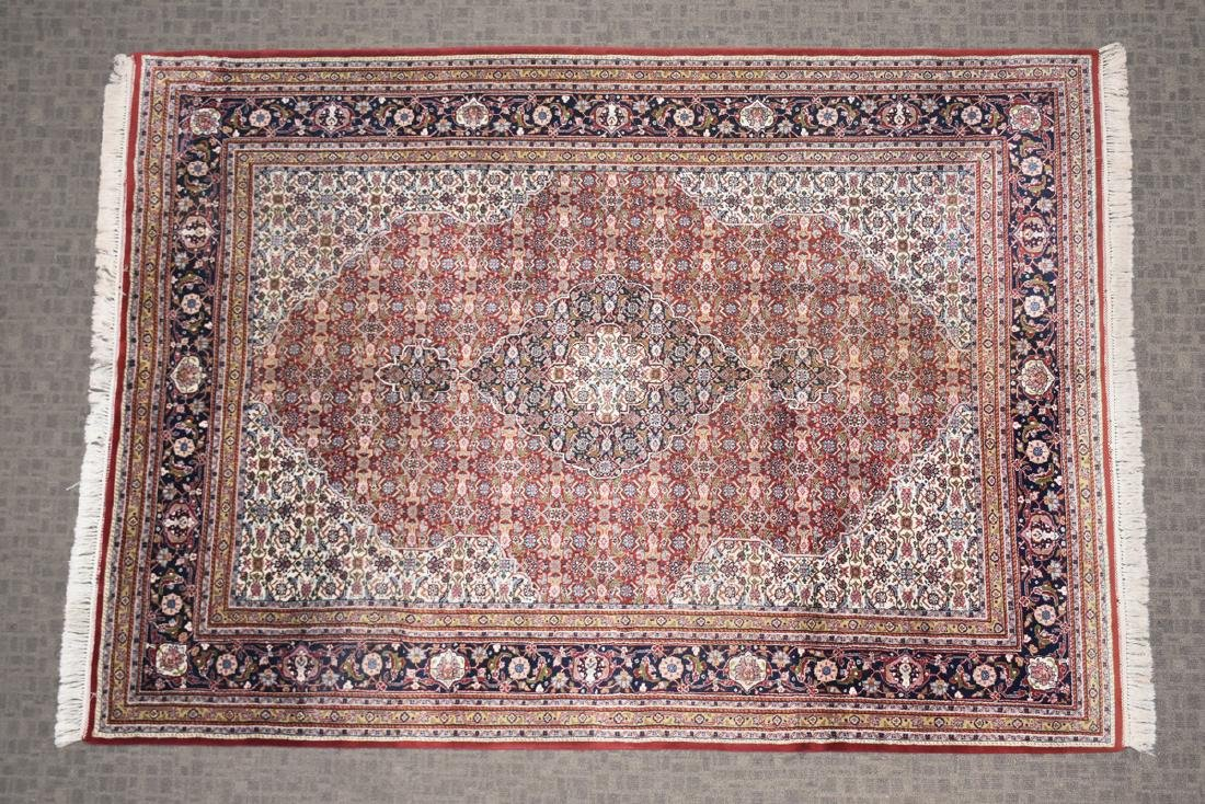 AN INDIAN HAND KNOTTED WOOL TABRIZ STYLE RUG, LATE 20TH - 2