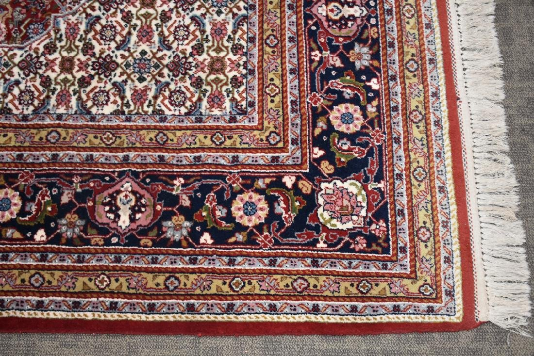 AN INDIAN HAND KNOTTED WOOL TABRIZ STYLE RUG, LATE 20TH - 3