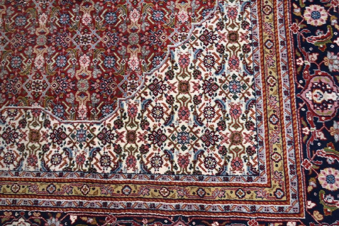 AN INDIAN HAND KNOTTED WOOL TABRIZ STYLE RUG, LATE 20TH - 4