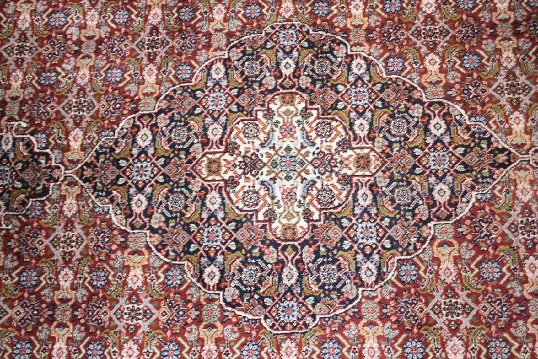AN INDIAN HAND KNOTTED WOOL TABRIZ STYLE RUG, LATE 20TH - 5