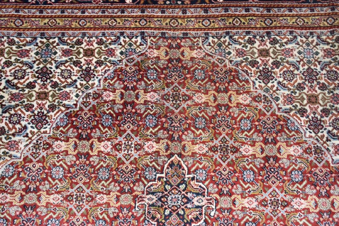 AN INDIAN HAND KNOTTED WOOL TABRIZ STYLE RUG, LATE 20TH - 6