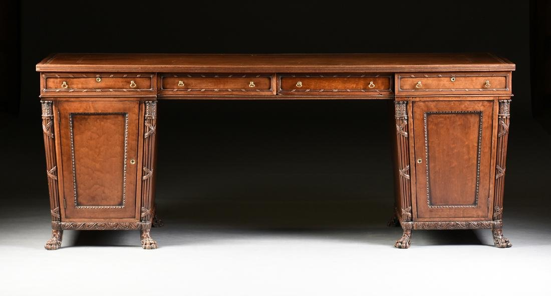 AN EGYPTIAN REVIVAL MAHOGANY PARTNER'S DESK, EARLY 20TH