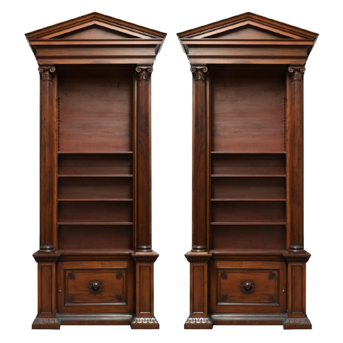 A MONUMENTAL PAIR OF REGENCY STYLE MAHOGANY BOOKCASES,