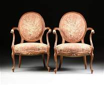 A PAIR OF TRANSITIONAL LOUIS XVXVI STYLE CARVED WALNUT