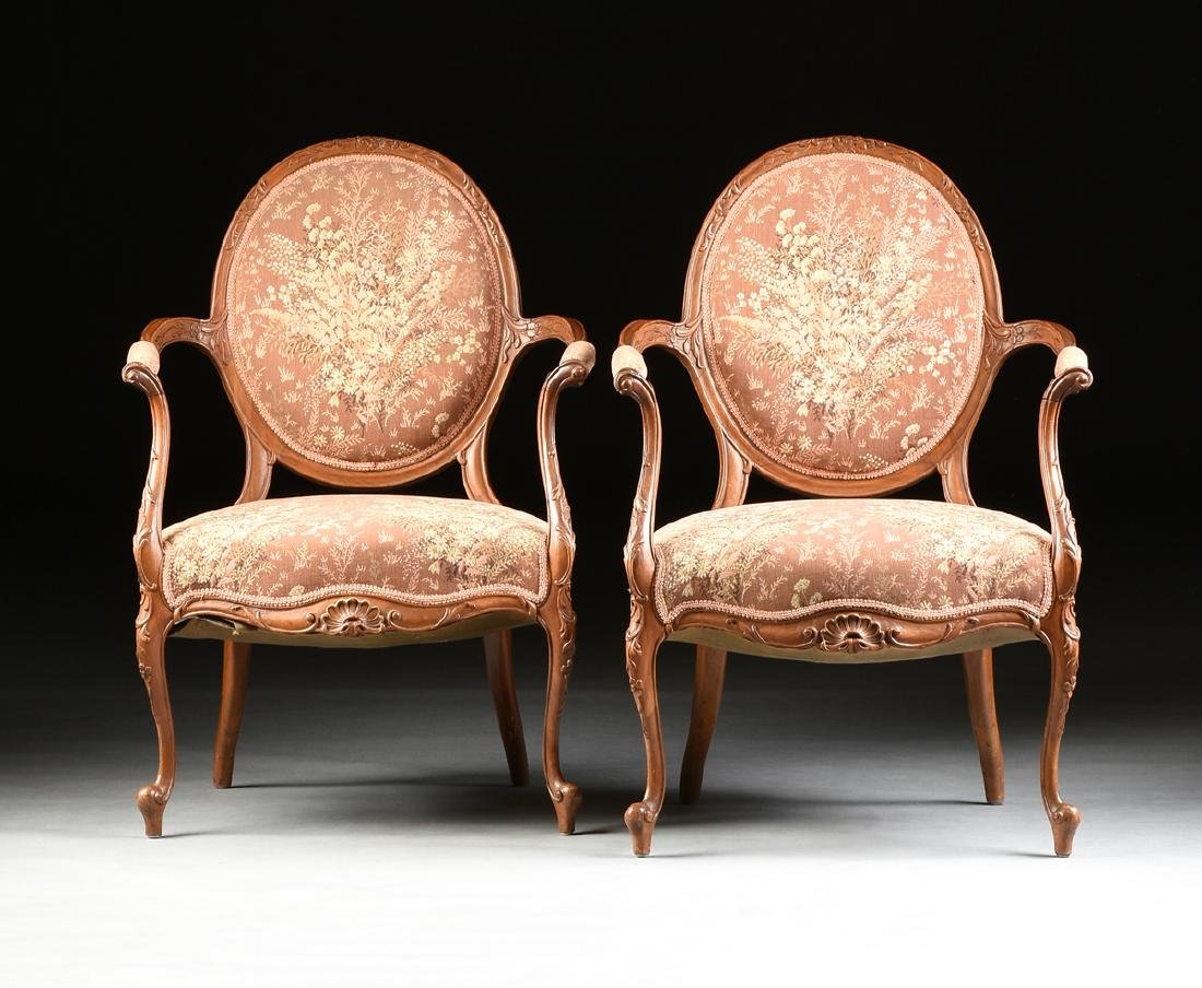 A PAIR OF TRANSITIONAL LOUIS XV/XVI STYLE CARVED WALNUT