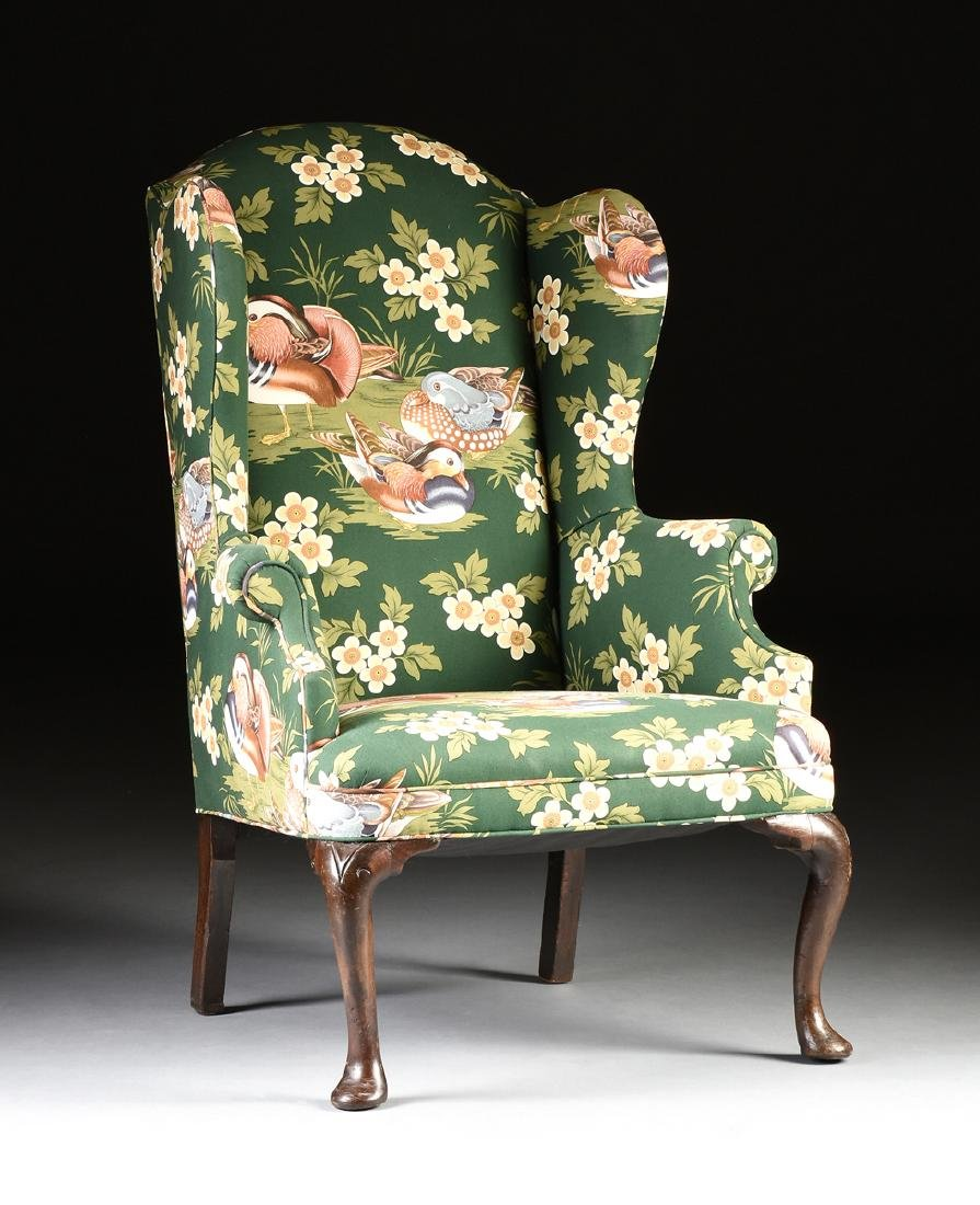 A GEORGE II CARVED BEECH WING BACK ARMCHAIR, ENGLISH,