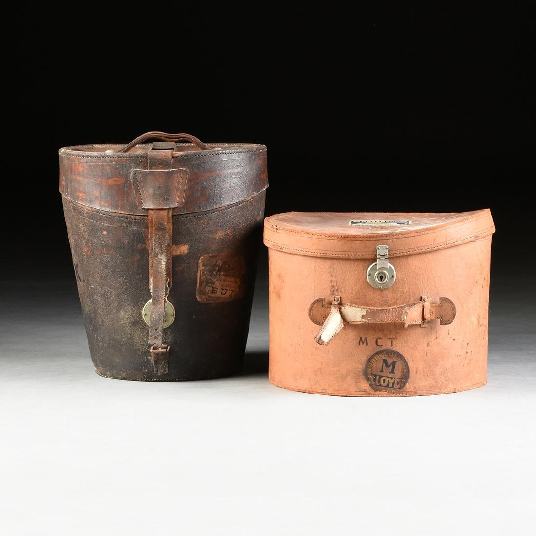 A GROUP OF TWO LEATHER TRAVELING HAT CASES, CIRCA