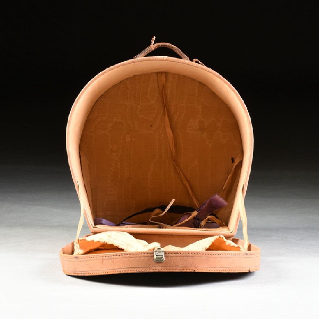 A GROUP OF TWO LEATHER TRAVELING HAT CASES, CIRCA - 4