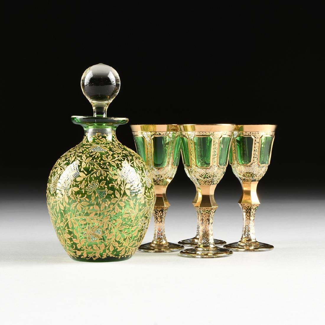 A GROUP OF FIVE CZECH GILT DECORATED GREEN GLASS ITEMS,