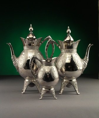 8: A THREE PIECE SILVER PLATED COFFEE SERVICE by Meride