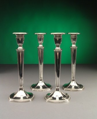 22: A SET OF FOUR STERLING SILVER CANDLESTICKS by Inter