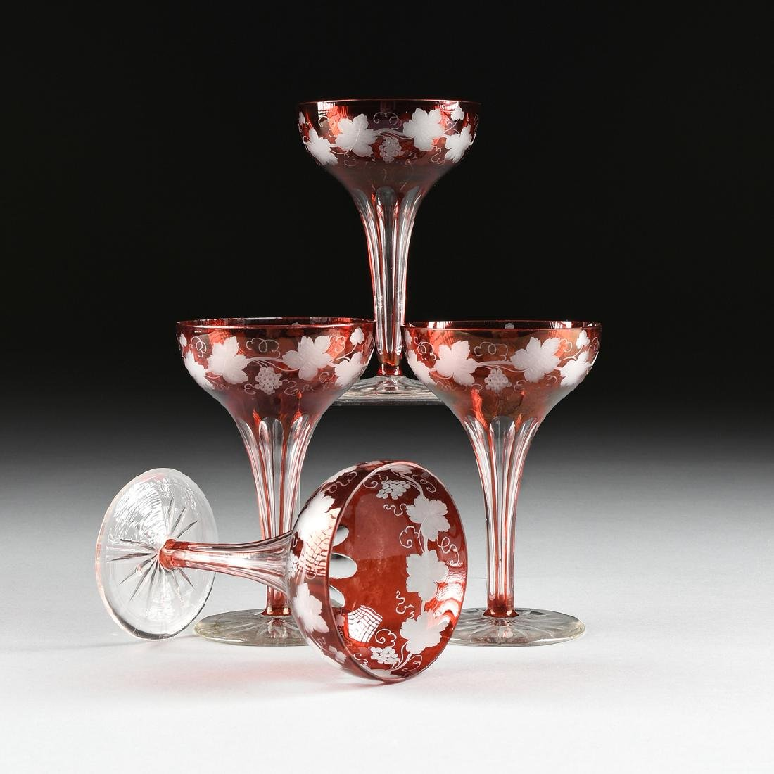 A SET OF FOUR BOHEMIAN RUBY FLASHED GLASS CHAMPAGNE